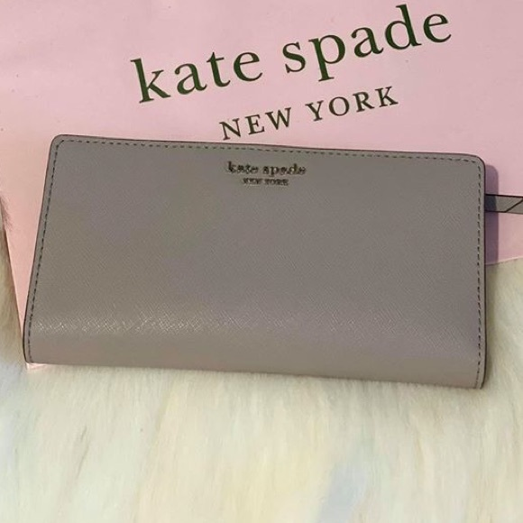 kate spade Handbags - LARGE SLIM BIFOLD WALLET